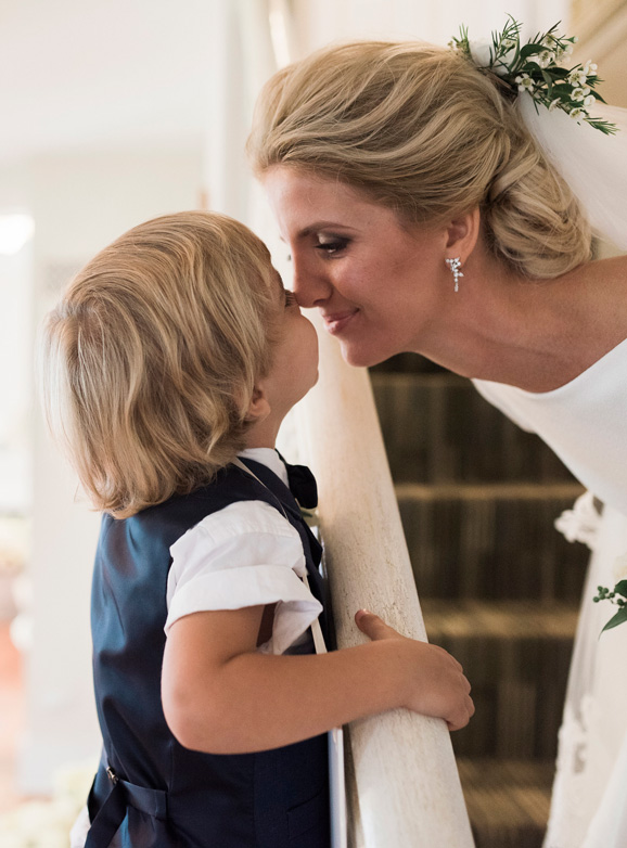 The bride gives her son a kiss