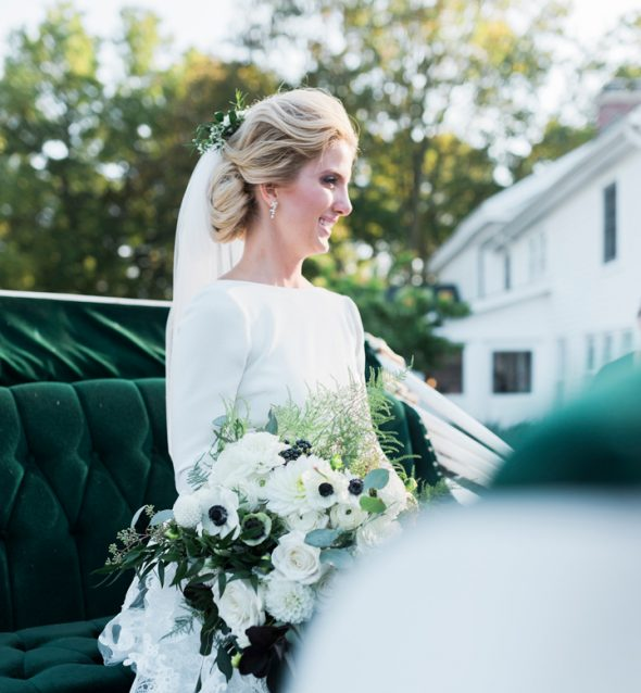 Bride arrives in horse-drawn carriage