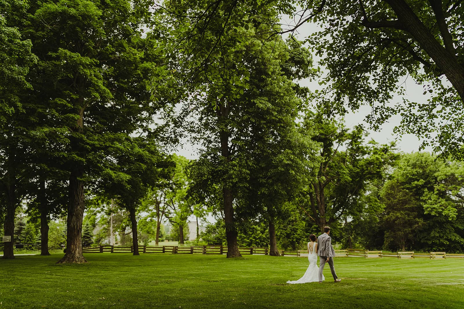 Bride and groom walk the grounds
