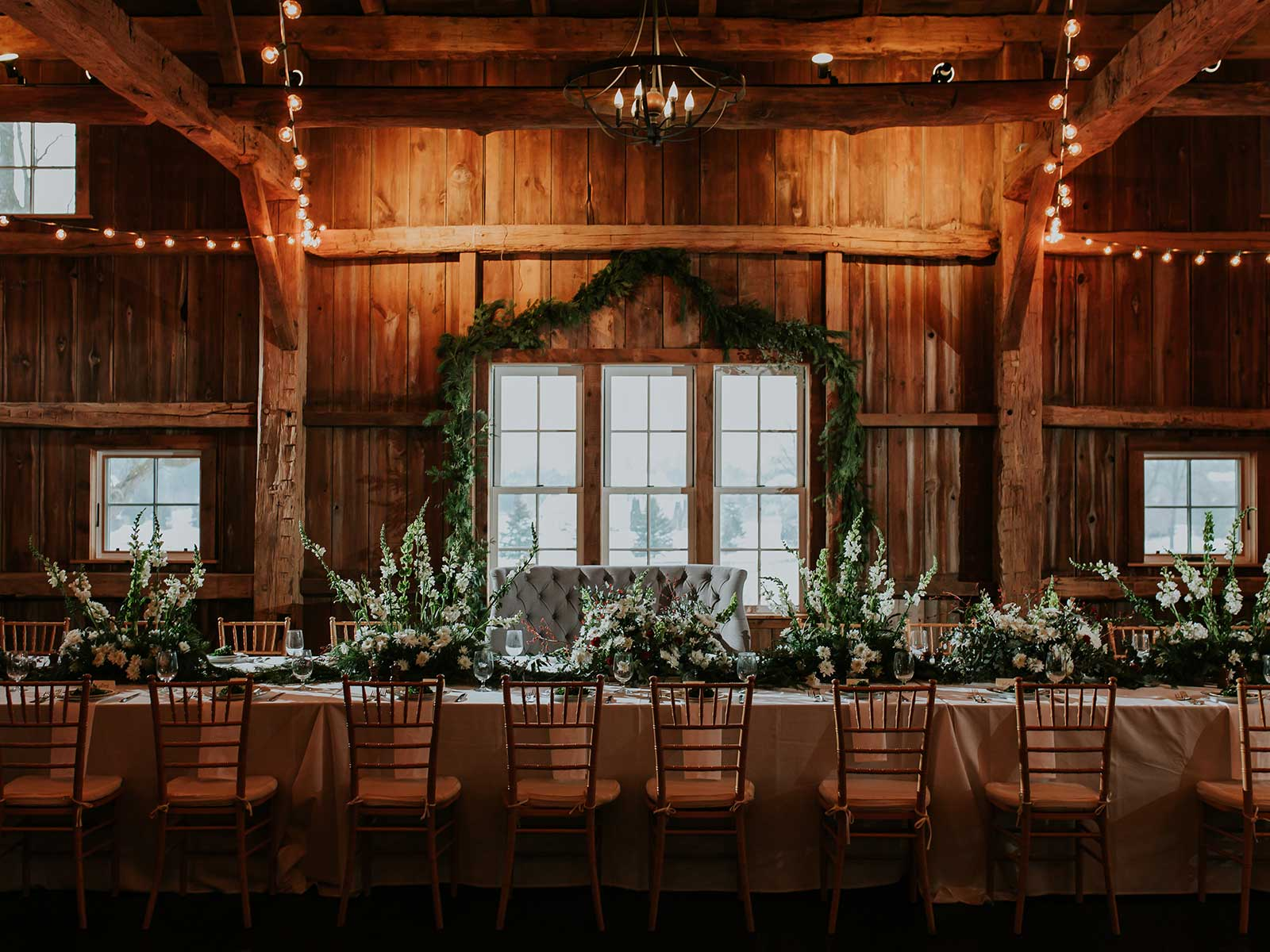 Beautiful wedding table setting in Zingerman's Red Barn