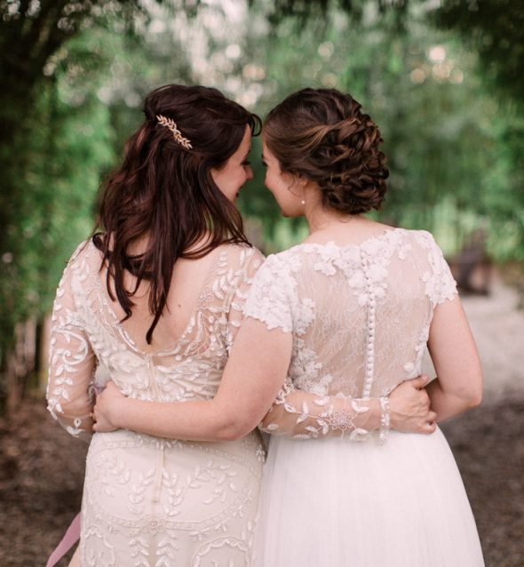 Two brides turning away from the camera