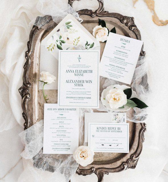 Wedding invitations on a metal tray