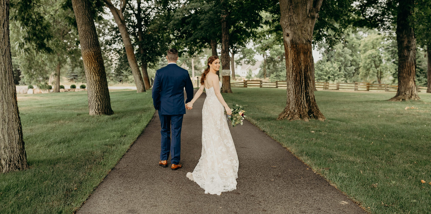 Bride and groom on pathway