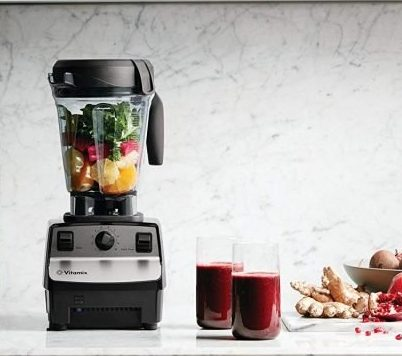Image of fruits in a Vitamix 5300 Blender with two glasses od smoothie.