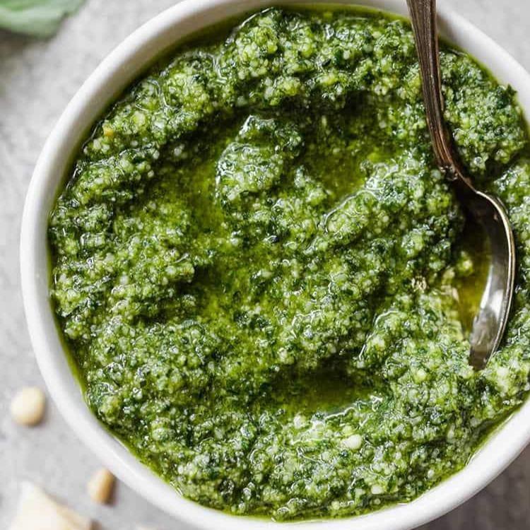 close shot of pesto basil sauce in a bowl